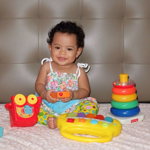 Portrait of cute girl playing with toy at home
