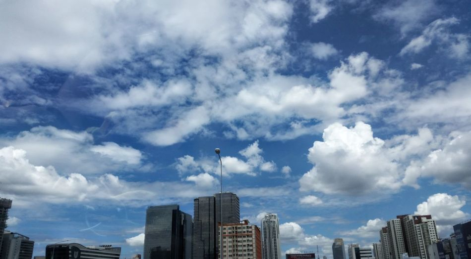 Low angle view of cityscape against sky