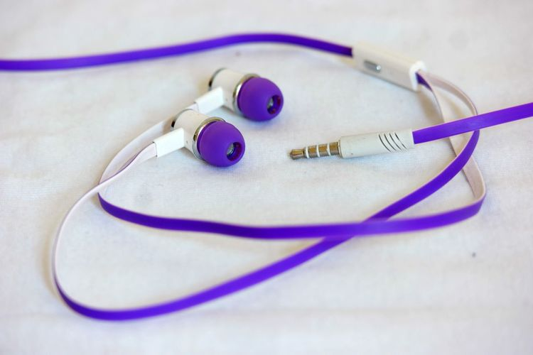 Close-up of earphones on white fabric
