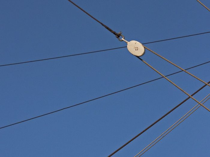 Low Angle View Of Pulley With Ropes Against Clear Sky
