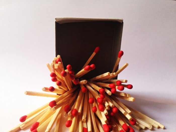Close-Up Of Matchsticks Against White Background