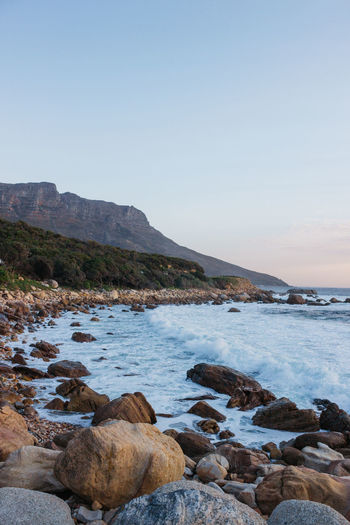 The Coastal Road. Just off the Atlantic Ocean in Cape Town - a series. Mid July, 2018. Water Sky Rock Scenics - Nature Beauty In Nature Solid Sea Rock - Object Tranquility Tranquil Scene Clear Sky Nature Mountain Land No People Day Beach Copy Space Idyllic Outdoors Rocky Coastline Pebble Cape Town South Africa Jonnynichayes Ocean Wave Waves Blue Mountain Range Rocks Popular Photos My Best Photo My Best Travel Photo Coastline Coast Evening Sunset Sunset_collection Beautifulinnature