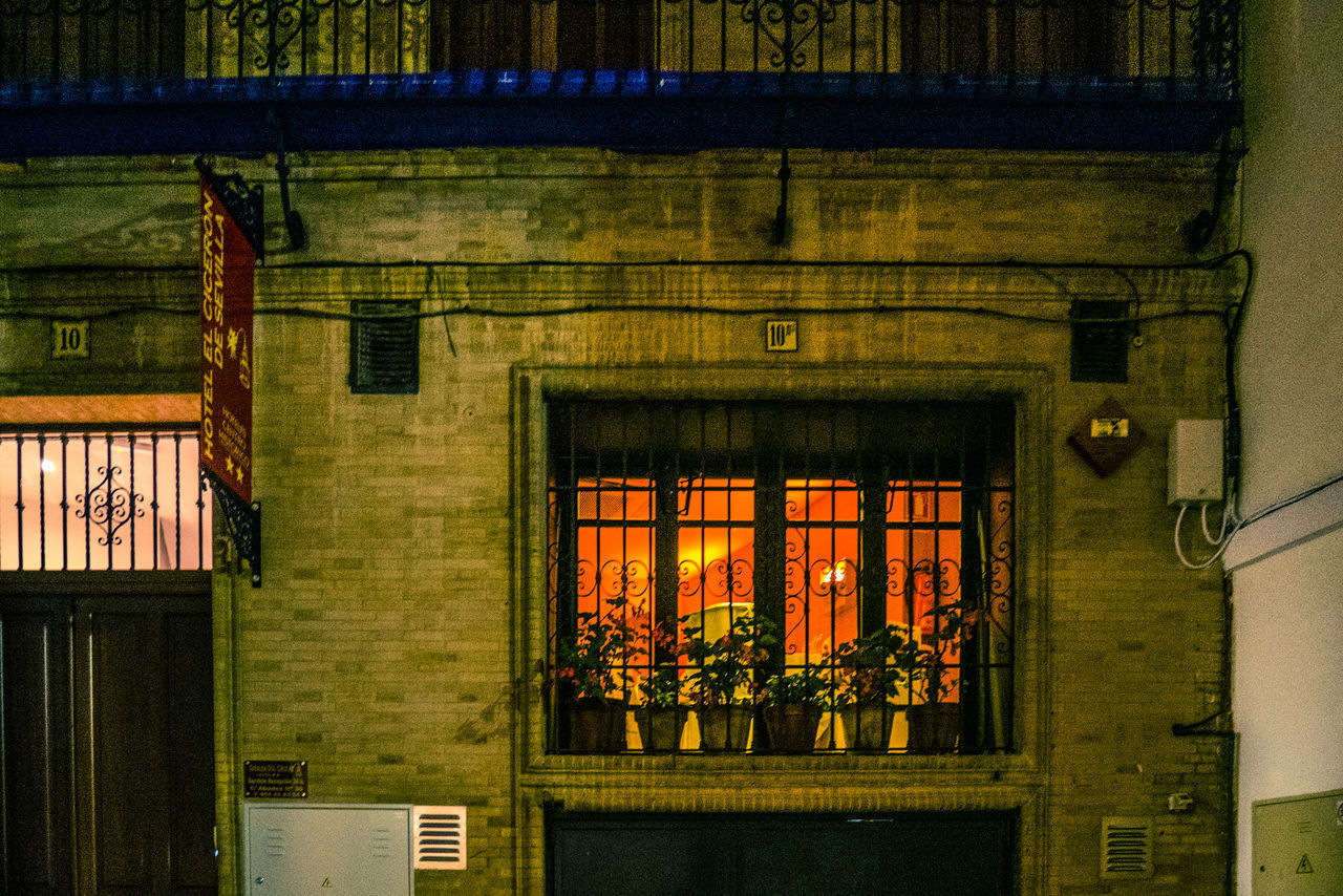 architecture, built structure, window, building exterior, building, no people, night, illuminated, residential district, entrance, city, outdoors, house, heat - temperature, door, nature, lighting equipment, glass - material, red