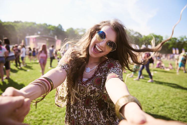 Portrait of young boho woman having fun at festival Music Festival Traditional Festival Woman Dance Music Party Boho Fun Carefree Freedom Portrait Summer Outdoors Scream Shout Arts Culture And Entertainment Youth Culture Holi Festival Adult Young Adult Sunglasses Fashion Fashionable Happiness Joy Enjoyment Smiling Positive Emotion Playful Popular Music Concert Sunlight Sunny Beautiful Woman on the move Mouth Open Look At Camera