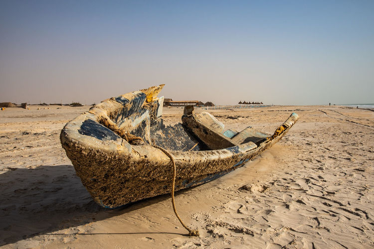 Boat Breaking Land Sand Tranquil Scene Nautical Vessel Copy Space Non-urban Scene Sea Climate Outdoors Driftwood Arid Climate Beauty In Nature Horizon Day Water Abandoned Tranquility Scenics - Nature Clear Sky Nature Beach Sky Rope The Photojournalist - 2019 EyeEm Awards