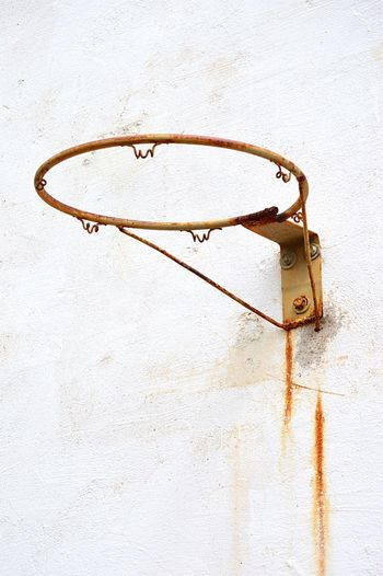 High angle view of rusty basketball hoop against wall