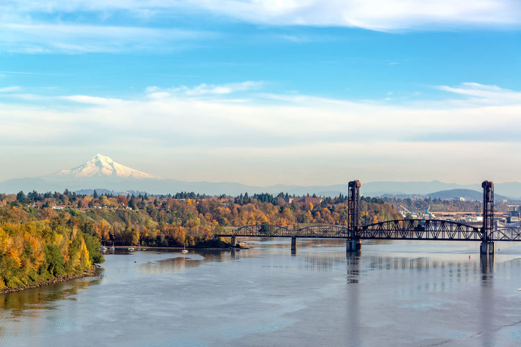 Burlington Northern Railroad Bridge and Mt. Hood seen from Portland, Oregon Portland Oregon Travel Travel Destinations Tourism Pacific Northwest  Mt Hood Mount Hood Sky Cloud - Sky Beauty In Nature Scenics - Nature Nature Mountain Tranquil Scene Tranquility No People Day Non-urban Scene Outdoors Cascade Mountains Volcano Snow Capped Autumn Autumn colors Fall Fall Colors Willamette River  River Burlington Northern Railroad Bridge Bridge Bridge - Man Made Structure Water Waterfront Reflection Architecture Idyllic Built Structure Connection