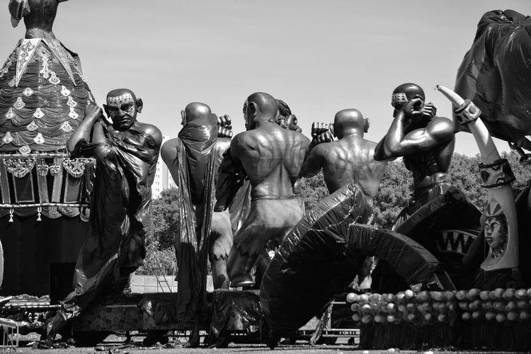 Sculptures against clear sky
