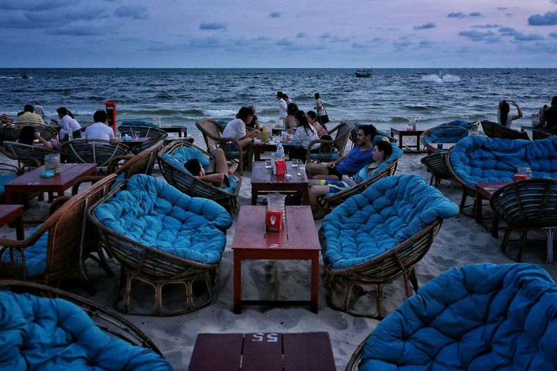 Tourists at outdoors restaurant on beach