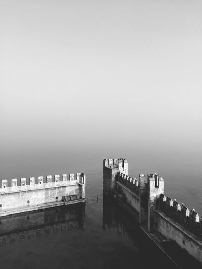 High angle view of pier on sea in foggy weather