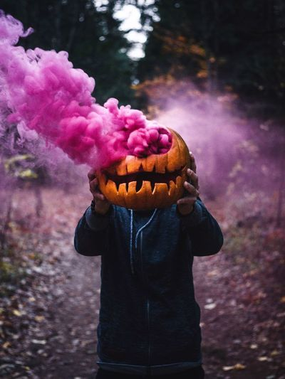 Focus On Foreground One Person Day Real People Nature Pink Color Holding Plant Freshness Purple Flowering Plant Outdoors Food Standing Flower Lifestyles Leisure Activity Food And Drink Three Quarter Length Pumpkin Halloween Smoke Smokebomb Vacations Holiday