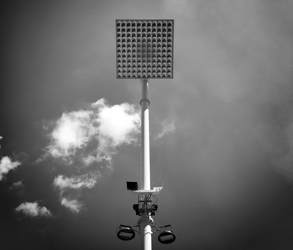Low angle view of flood light against sky