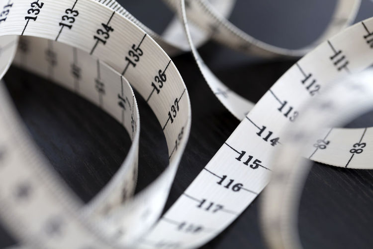 Measuring tape. Closeup. Curve Curves Measuring Measuring Tape Sewing Sewing Stuff Tailoring Accuracy Centimeter Close-up Curvy High Angle View Indoors  No People Number Ruler Selective Focus Sew Still Life Swirl Tape Tape Measure Tool