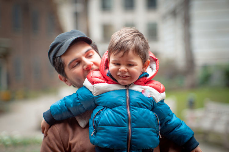 Portrait of father and son during winter