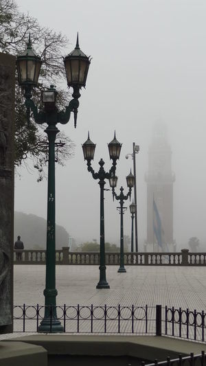 Lamp posts on footpath at plaza san martin during foggy weather