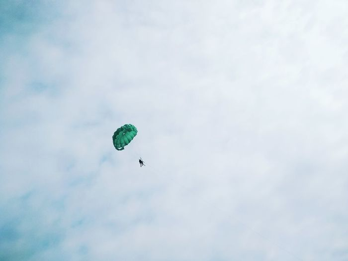 The Week on EyeEm Adventure Cloud - Sky Day Extreme Sports Flying Freedom Leisure Activity Lifestyles Low Angle View Mid-air Nature One Person Outdoors Parachute Paragliding Parasailing Real People Sky Sport Transportation Unrecognizable Person The Minimalist - 2019 EyeEm Awards