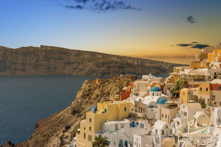 View of Oia sunset - Santorini Cyclades Island - Aegean sea - Greece Building Exterior Architecture Built Structure Water Sky Building Sea City Residential District Nature High Angle View No People Mountain Town Land Travel Destinations Scenics - Nature TOWNSCAPE Santorini Greece Oia Sunset Island Cyclades Aegean