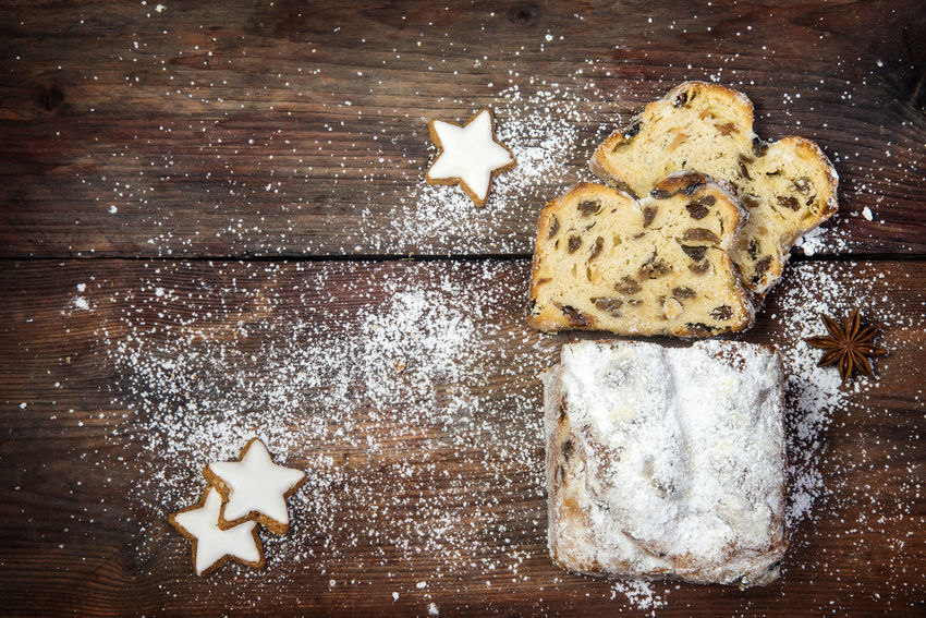 christmas background, traditional german criststollen cake sprinkled with icing sugar, cinnamon cookies and anise stars on a dark rustic wooden board, top view from above, copy space Christmas Dark Background Baked Cake Christstollen Cookie Day Food Food And Drink High Angle View Indoors  No People Shape Star Shape Still Life Sweet Food Table Wooden