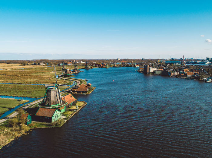 High angle view of river amidst city against sky