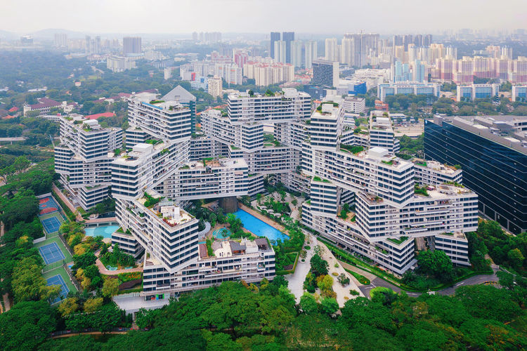 The Interlace apartments in Singapore city and skyscrapers buildings. Modern architecture background. Aerial view Aerial Shot Architecture City Cityscape Financial District  Singapore Aerial View Architecture Building Building Exterior Buildings Built Structure City City Life Cityscape Day Downtown District High Angle View Interlace Landscape Modern Nature No People Office Building Exterior Outdoors Residential District Sky Skyscraper Travel Destinations Tree