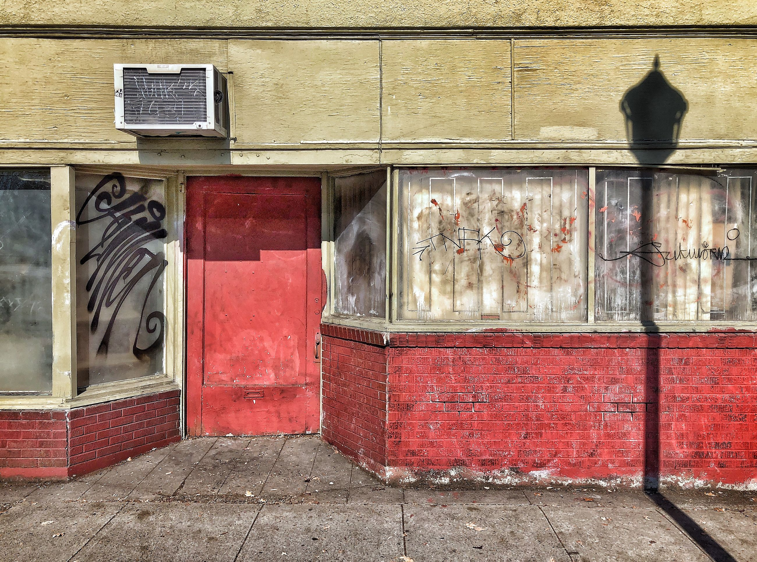 architecture, built structure, building exterior, day, no people, building, wall - building feature, red, window, door, outdoors, entrance, glass - material, old, wall, closed, sunlight, city, reflection, brick wall, brick, glass