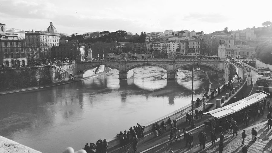 Ponte sant angelo over tiber river against sky in city