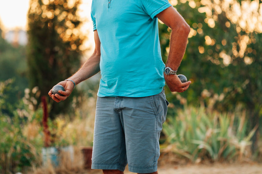 Adult Blue Shirt Blue Shirt Day Casual Clothing Close-up Day France French Jeans Lifestyles Men Nature One Man Only One Person Only Men Outdoors People Petanque Play Sport Summer Exploratorium Visual Creativity