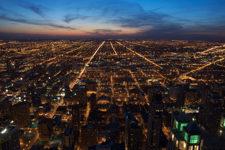 Aerial view of downtown Chicago at dusk, looking west. Aerial View Architecture Chicago Cityscape Downtown Dusk High Angle View Horizon Illinois Mesh Nightscape Overhead Skyline Skyscrapers Street Sunset Traffic United States Of America Urban USA