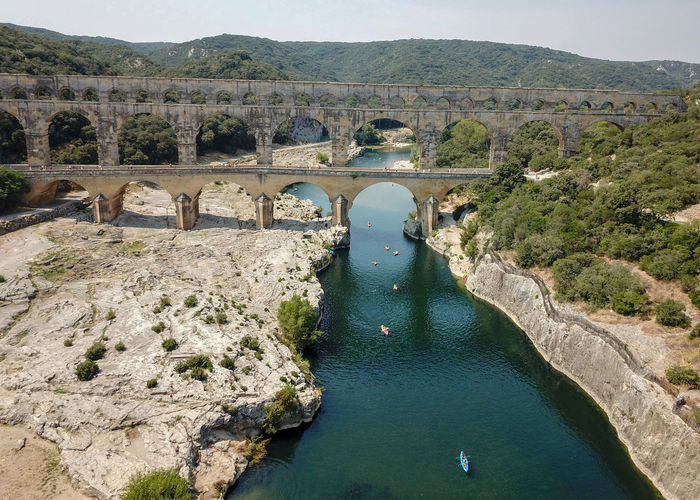 Pont du Gard, France Landscape Travel Traveling Landscape_Collection Landscapes Nature Beauty In Nature Naturelovers EyeEm Nature Lover EyeEm Best Shots DJI Mavic Pro Drone  Dronephotography Dji Droneshot Aerial View Bridge River France Eye4photography  EyeEm Gallery Pont Du Gard Bridge - Man Made Structure Architecture_collection On The Road Nature_collection Water Architecture Arch Bridge Scenics Summer Sports