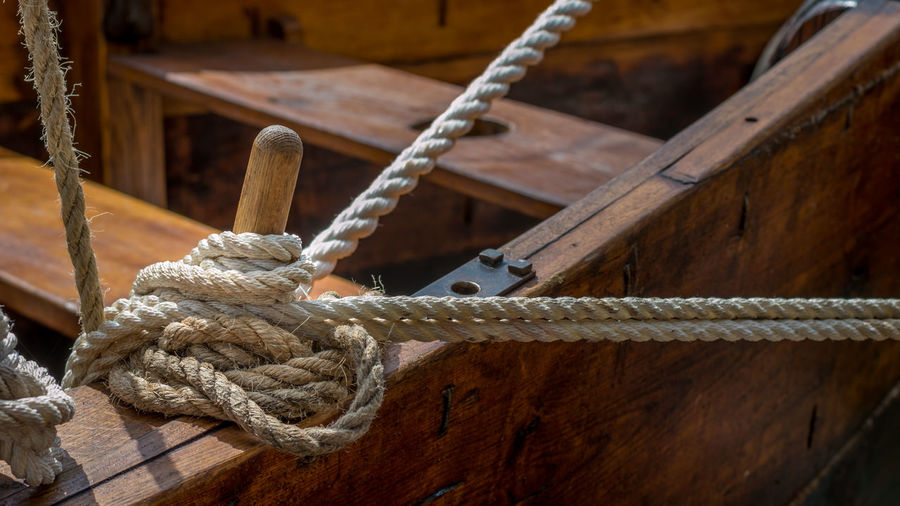 Close-up of rope tied on wooden boat