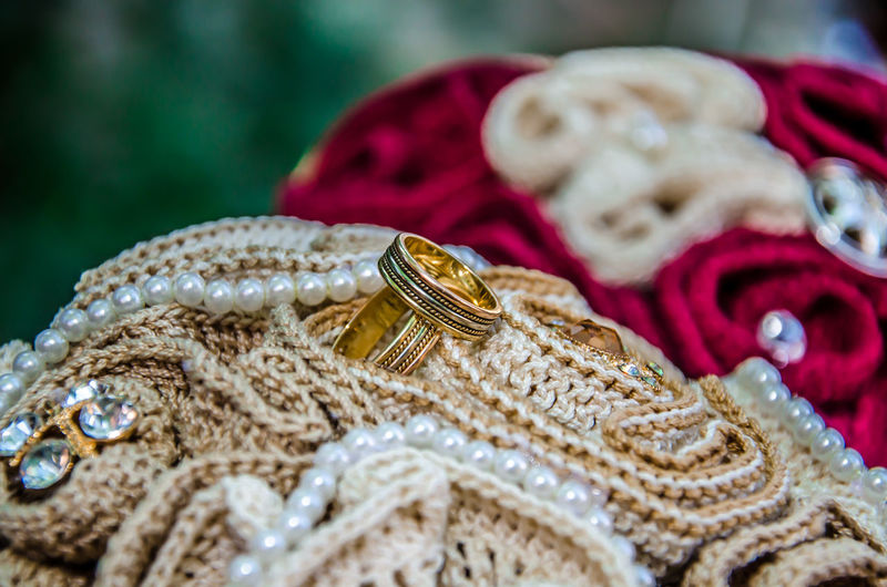Close-up of wedding rings on fabric