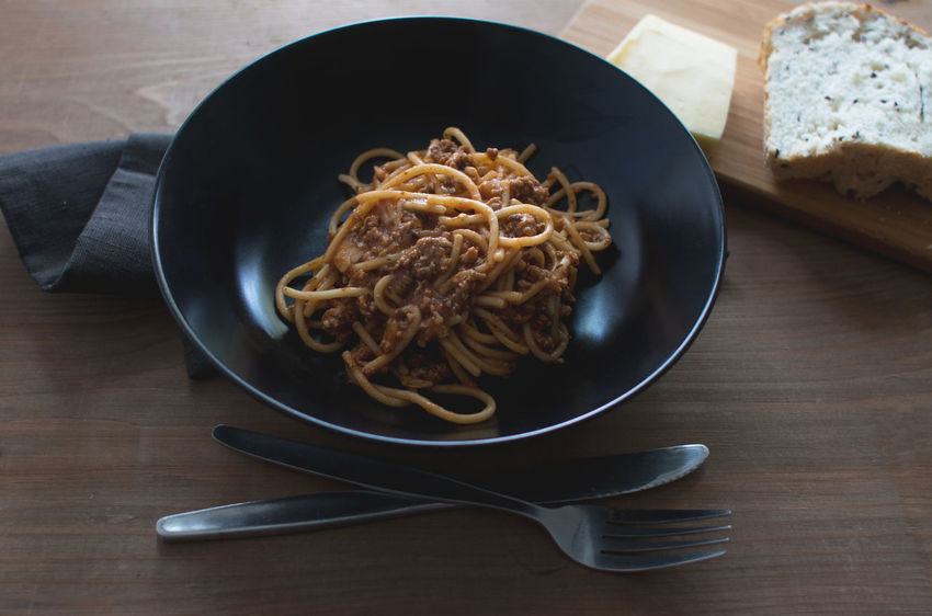 Cheese! Darkness Lunch Rustic Spaghetti Black Bowl Bolognese Bolognese Sauce Easy Recipe Hipster Italian Dishes Italian Food Meat Old Table Outdoors Pasta Pasta Time Recipe Rustic Table Sauce Spaghetti Bolognese Table Wood - Material Wooden Old Table