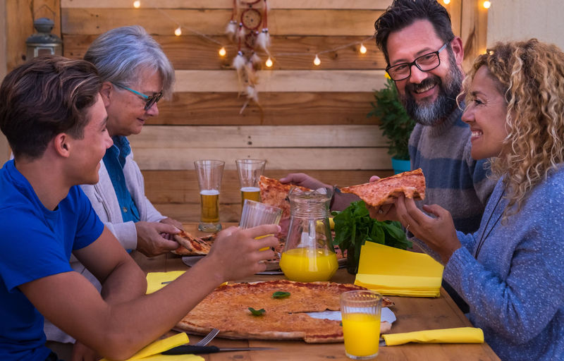 Happy people at table in restaurant