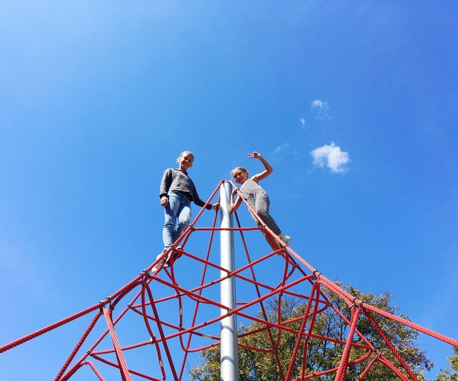 Sporty Girls Children Sisters Low Angle View Sky Blue Nature Day Rope Outdoors Built Structure Sunlight Climbing