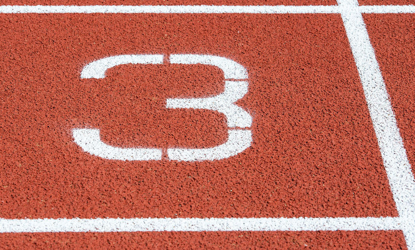 High angle view of number 3 on running track
