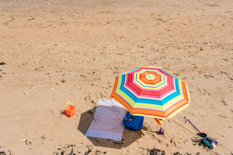 High angle view of colorful umbrella at beach