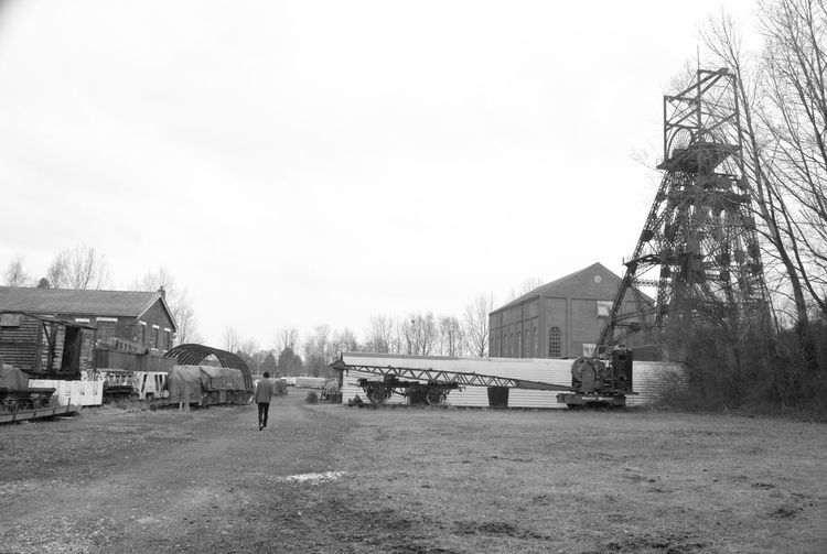 Tree Winter Sky Outdoors Cold Temperature Built Structure People Day City Nature Architecture History Through The Lens  History Mining Heritage Lancashire Coalfield Mining Coal Mine Industry Mine Headframe Mine Headgear Black And White Photography Black And White