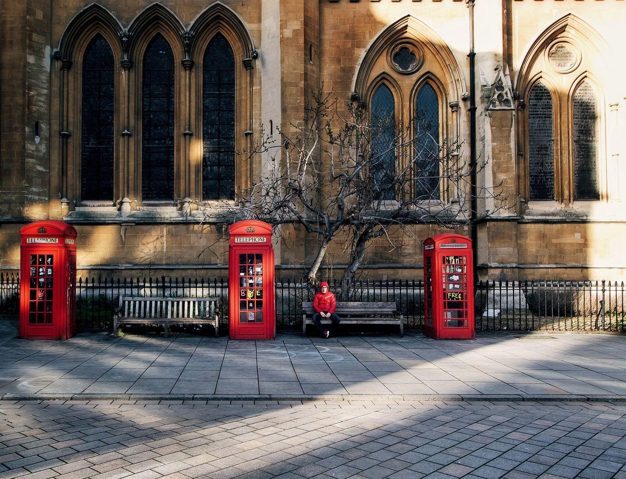 Man sitting on bench in city