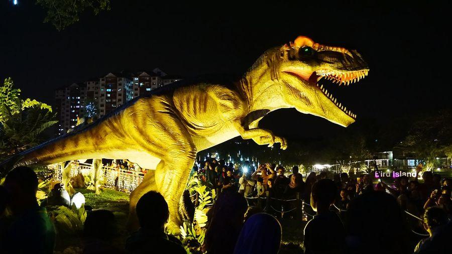 Tourist take photo of t rex dinosaur at wonderland park,Malaysia. Dinosaurs Dinosaur Park Dinosaur Land Dinosaur World Theme Park Travel Destinations Visitors Crowded People Selangor, Malaysia Kuala Lumpur Attraction Park Leopard Animal Themes