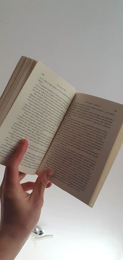 Cropped image of hand holding book
