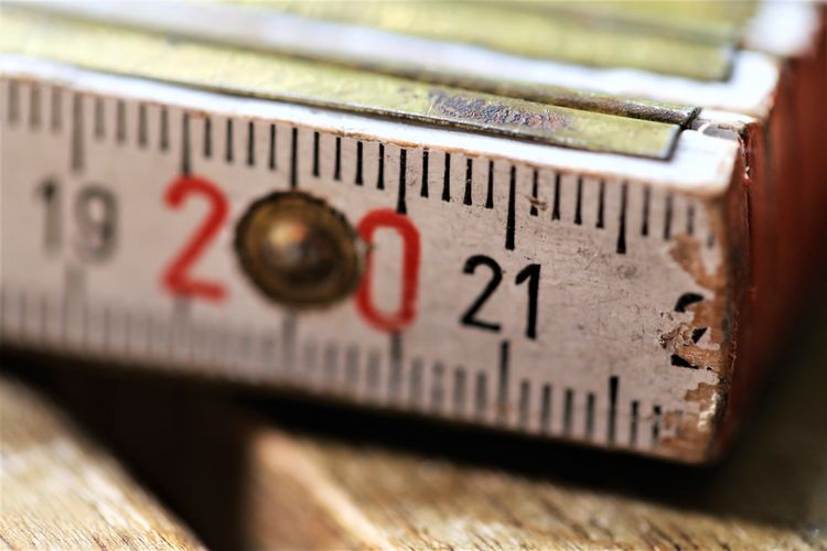 Indoors  Accuracy Still Life Communication Instrument Of Measurement Number No People Selective Focus Close-up Finance Wood - Material Old Business Studio Shot Nostalgia Western Script Metal Text Scale