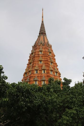 Architecture Built Structure Building Exterior Low Angle View Tree Religion Spirituality Pagoda Religion Temple - Building Place Of Worship Clear Sky Spire  Sky Outdoors History Tall The Past Culture Day Landscaped Tourism Travel Destinations Kanchanaburi Famous Place