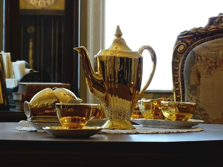 Tea anyone? Focus On Foreground Indoors  Reflection Gold Color Tea Set Tea Cups Table Luxury