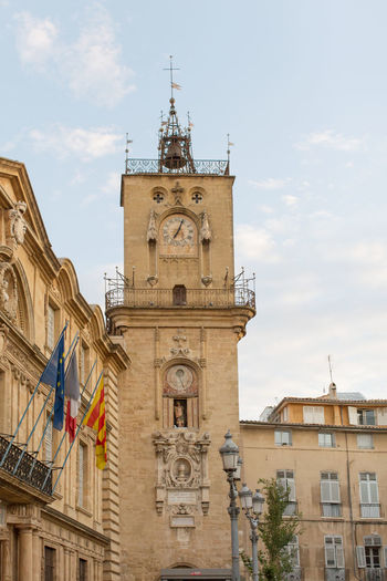 The clock tower and the Town Hall square (Place de l'Hôtel de Ville) Architecture Bell Tower Building Exterior Built Structure City Life Clock Tower Cloud - Sky Day Famous Place History Low Angle View Old Town Outdoors Sky Tourism Town Hall Travel Destinations