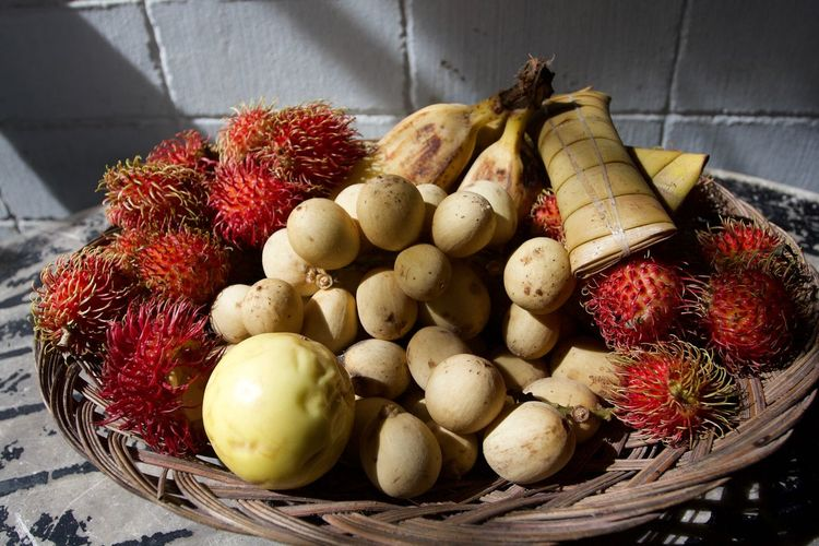 Fruits in a native platter -- includes Lanzones, passion fruit, lychees, saba (type of banana that can be cooked), and ibos (glutinous rice wrapped in buri or palm leaves -- all these are native to Naga (Bicol region) and in other regions of the Philippines. Lanzoes is a very sweet fruit, but warning on biting on the seeds (very bitter) Basket Close-up Day Food Food And Drink Freshness Fruit Healthy Eating High Angle View Ibos Ibosumun Indoors  Lanzones No People Passion Fruit Red Saba Variation