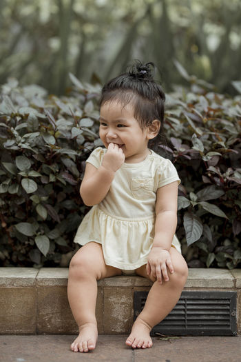 Kids being kids. Facial Expressions. Eyeem Philippines Kids Of EyeEm The Week on EyeEm Babies Baby Babyhood Child Childhood Cute Day Front View Full Length Innocence Nature One Person Outdoors Plant Portrait Real People Sitting Toddler  Toddler  Toddlers  Young International Women's Day 2019