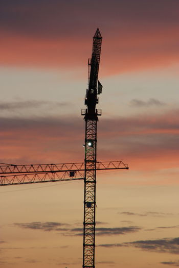 End of working day Architecture City Construction Work Workplace Building Change Cloud - Sky Crane - Construction Machinery Cransmontana End Of Working Day Evening High Above No People Orange Color Outdoors Silence Sky Sunset The Graphic City Colour Your Horizn