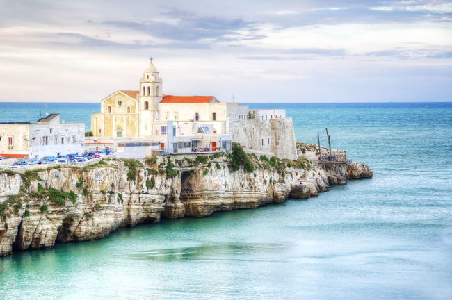 Seascape from Vieste (FG) Italy Adriatic Sea Ancient Church Cliff Colorfull Glimpse HDR Italy Light Blue Pug Reef Rocky Coastline Scenics Sea Seascape Summer Sunset Tourism Tranquil Scene Trebuchet Vacation Vieste Village Waterfront Wave