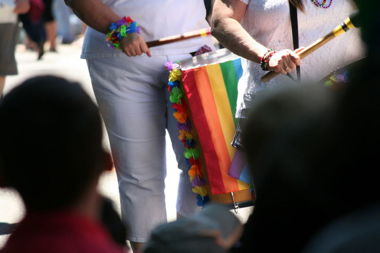 Midsection Of People Playing Drum At Gay Pride Parade