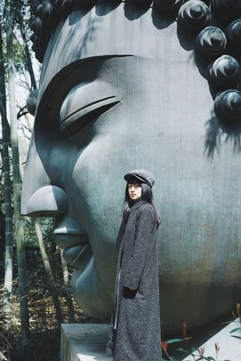 Side View Statue Buddha One Person Young Women Real People Portrait Women Leisure Activity Looking At Camera Standing